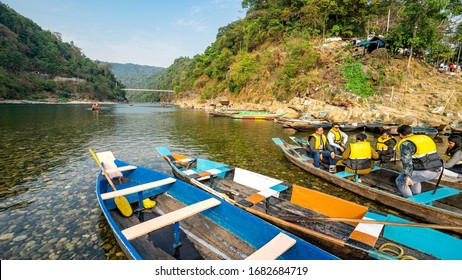 Meghalaya,11March 2020 : Tourists  enjoy boating in crystal clear green waters and  natural landscapes in River Umngot at Dawki , Meghalaya,  North East, India,Asia