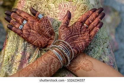 Mehendi hands of a Indian woman with selective focus.