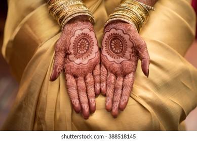 Mehendi Henna pattern on Malayalee bride at a wedding