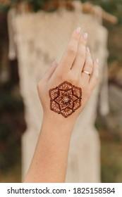 mehendi on hand, henna drawings on the body