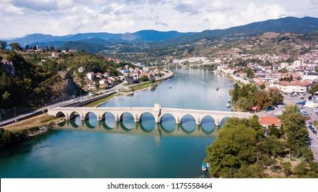 The Mehmed Pasha Sokolovic Bridge  is a historic bridge in Visegrad, over the Drina River in eastern Bosnia and Herzegovina.  The bridge is a UNESCO World Heritage Site.