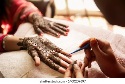Mehndi artist making mehndi bridal hand Karachi, Pakistan, May 01, 2019