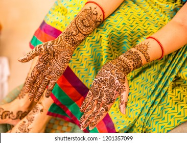 Mehndi Hands of an Indian Bride, tattooed with natural and local dye, Mehndi or Henna. during a Hindu wedding ceremony.