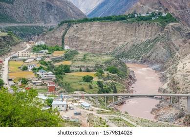 "Meilixueshan - Deep valley of Mekong river with bridge in Meili Snow Mountain (Kawa Karpo) range in Deqin, Yunnan Province, China. Translation is ""Bridge of Friendship""."