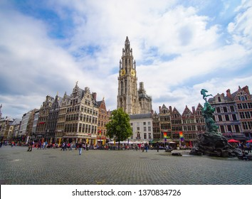 Meir street, lonely tower of the Cathedral of our lady,fountain with Statue of Brabo in Grote Markt square with rainbow flag the sign of LGBT pride flag in Antwerpen, Belgium in June 2018.