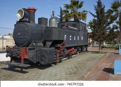 MEJILLONES, ANTOFAGASTA REGION, CHILE - SEPTEMBER 1, 2017: Historic steam engine in the coastal city of Mejillones in the Antofagasta Region of Chile