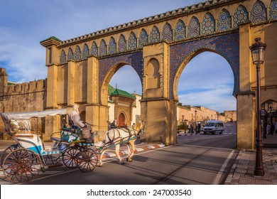MEKNES - DECEMBER 23: A tourist coach crosses Bab Moulay Ismail in front of the famous mausolem on December 23 2014 in Meknes, Morocco