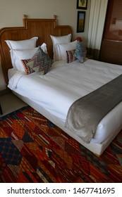 MEKNES, MOROCCO - FEB 12, 2019 - Bedroom suite in a luxury hotel, Chateau Roslane, Meknes, Morocco, Africa