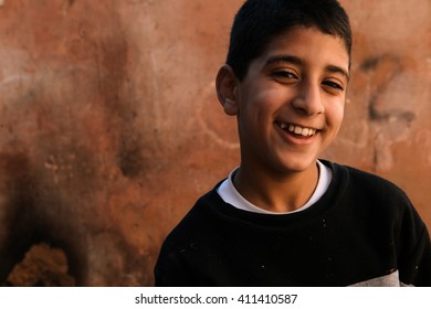 Meknes, Morocco - November 07, 2015 - March 12 2015: Boy smiles posing in the street