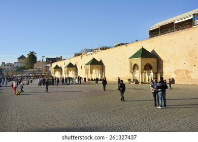 MEKNES, MOROCCO - NOVEMBER 19: Unidentified people on place el-Hedim with city wall and restaurants, a preferred place with different street performers, on November 19, 2014 in Meknes, Morocco