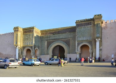 MEKNES, MOROCCO - NOVEMBER 19: Unidentified people in front of impressive Bab el-Monsour gate, a tourist attraction and landmark of the city, on November 19, 2014 in Meknes, Morocco