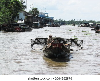 Mekong Delta near Ho Chi Minh City, Vietnam - December 15, 2013: fisherman in a boat over Mekong River in Vietnam