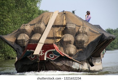 MEKONG DELTA, VIETNAM: DECEMBER 30. 2014: Overloaded sampan style boat with typical stylized bow eyes