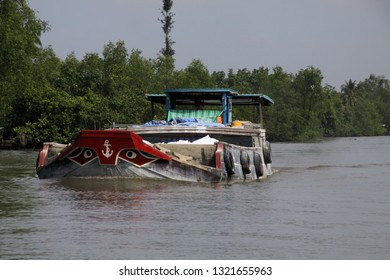 MEKONG DELTA, VIETNAM: DECEMBER 30. 2014: Sampan style boat with typical stylized bow eyes