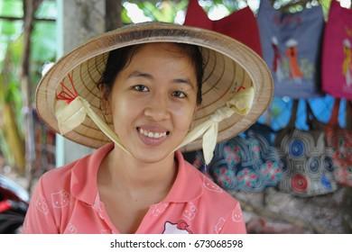 Mekong Delta, Vietnam - Jun 16, 2014 : Villager wearing Vietnamese  leaf hat called Non La at Mekong Delta. Mekong Delta is famous for its community-based ecotourism in Vietnam.