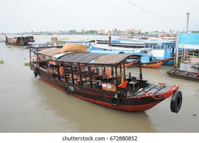 Mekong Delta, Vietnam - June 16, 2014 : Tourist boat docking at jetty in Mekong Delta. Community based ecotourism  is the main attraction in Mekong Delta.