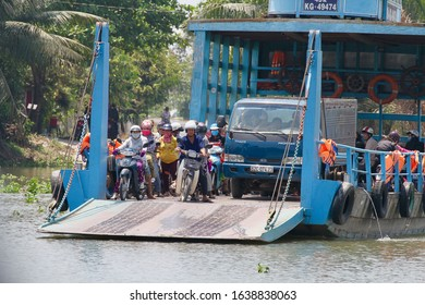 Mekong Delta / Vietnam: March 11, 2018: A vehicle ferry crossing one of the many waterways in the farming area of the Mekong Delta, Vietnam.