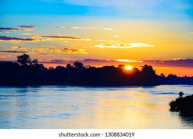 Mekong River 4000 islands Laos, sunrise dramatic sky, mist fog on water, famous travel destination backpacker in South East Asia