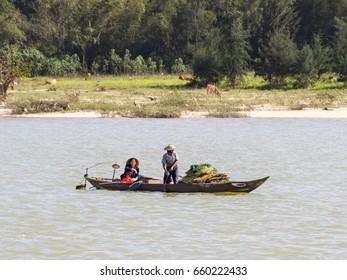 Mekong river delta in Vietnam – January 2017: [Vietnamese fishermen on a boat catching fish]