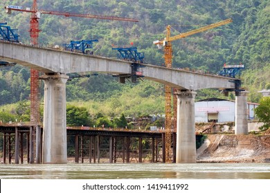 Mekong River, Laos - May 20, 2019: Bridges under construction over the Mekong River for the high speed railway linking China to the capital Vientiane in Laos