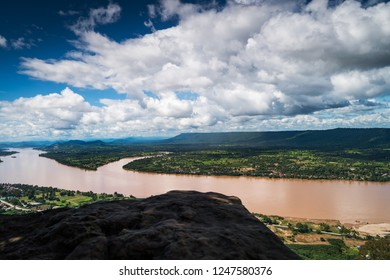 Mekong River At Nong Khai In Thailand, high angle view of landscape with cumulus clouds