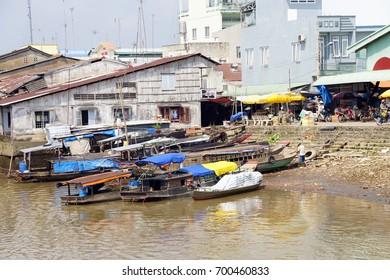 MEKONG RIVER, VIETNAM - FEB 6, 2015 - Small Working boats on the banks of the  Mekong River,  Vietnam