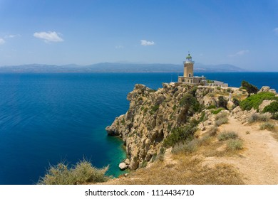 Melagavi lighthouse with endless blue sea in the background in Loutraki, Peloponnese Greece