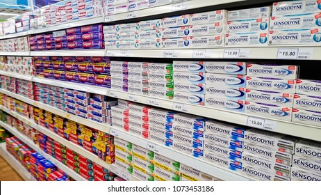 MELAKA, MALAYSIA - April 13, 2018 : Assorted brand of toothpaste on shelf rack display in the Tesco store.