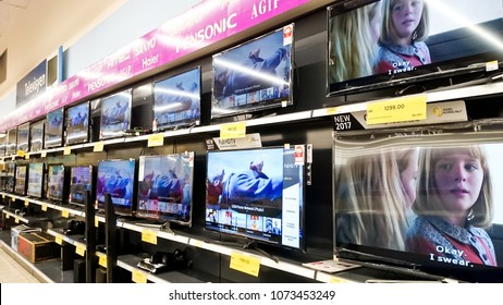MELAKA, MALAYSIA - April 13, 2018 : Assorted brand and type of LED TV on shelf rack display in the Tesco store.