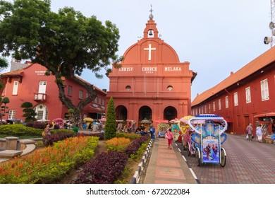 Melaka, Malaysia - April 20, 2017: The scenery at  Dutch Square, Melaka or Malacca, Malaysia, with famous Christ Church building and colourful trishaws for tourists visiting Melaka.