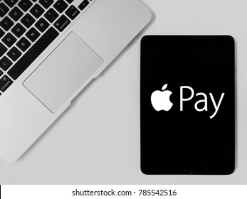 Melaka, Malaysia - Circa January, 2018: Flay lay concept with a laptop and tablet. Showing logo of Apple Pay