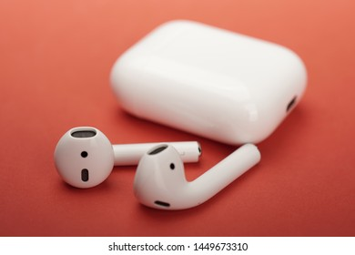 Melaka, Malaysia -  Circa July, 2019: The Apple Airpods. Bluetooth wireless earphone with wireless charging case.