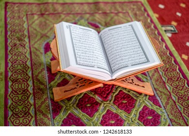 Melaka, Malaysia - Circa November, 2018: The Holy book of islam, the quran on the praying mat / sajadah