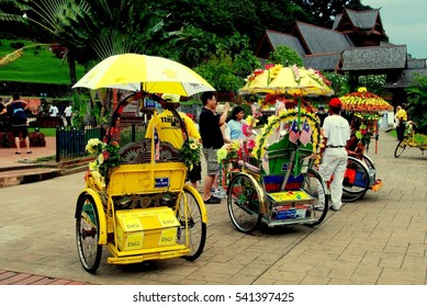 Melaka, Malaysia:- December 26, 2006:  Colorful tri-shaw taxis at A 'Famosa Square wait for fares in front of the entrance to the Istana Kesultanan Melaka (Sultanate Palace)