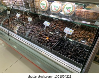 MELAKA, MALAYSIA - FEBRUARY 1, 2019: An unknown Muslim shop sells a variety of dates and other dry foods. Image contains certain grain or noise and soft focus.