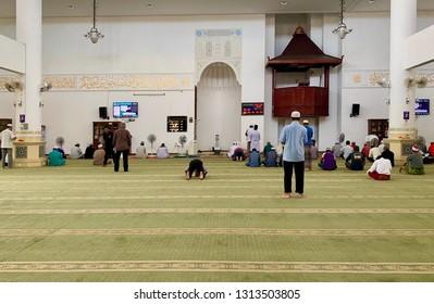 MELAKA, MALAYSIA- FEBRUARY 15, 2019: The scenary of Friday prayers at Masjid Al Alami, Melaka. Muslims must pray (prayer) 5 times a day. Image contain certain grain or noise and soft focus.