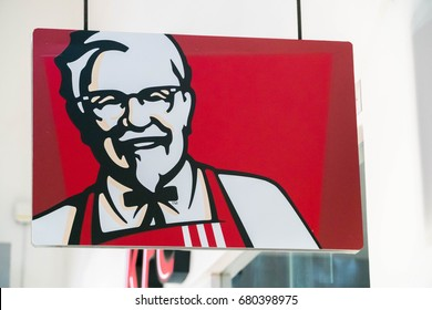 MELAKA, MALAYSIA - JULY 11, 2017: Colonel Sanders, the the official face of Kentucky Fried Chicken logo. KFC is a fast food restaurant chain that specializes in fried chicken.
