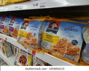MELAKA, MALAYSIA - JULY 17, 2019 : Assorted packs of instant oat meal brand QUAKER in the supermarket