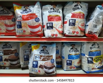 MELAKA, MALAYSIA - JULY 22, 2019 : Assorted packs of instant oat meal brand QUAKER in the supermarket