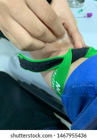MELAKA, MALAYSIA. JULY 31,2019: Close-up shot of doctor or nurse ready to take a blood sample from arm vein with a vacutainer. Venipuncture or venepuncture procedure.