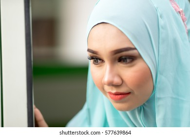 Melaka, Malaysia - June 26, 2016: Fashion portraiture of young beautiful muslim woman wearing hijab. Image contain certain grain or noise and soft focus.