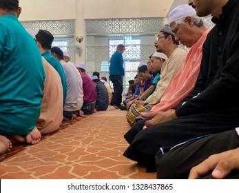 MELAKA, MALAYSIA- MARCH 1, 2019: Unidentified Muslim man in sits down in solat position Masjid Al Ghaffar, Jasin, Melaka. Muslims compulsory to pray (solat) 5 times a day.