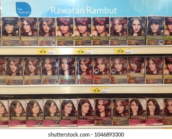 MELAKA, MALAYSIA - MARCH 12, 2018: Loreal Paris Excellence Creme Colour Hair product on supermarket shelf. Loreal is the world largest cosmetics company, headquartered in Clichy, France.