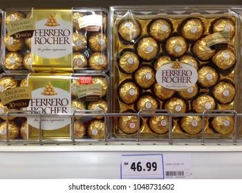 MELAKA, MALAYSIA - March 17, 2018 : Ferrero Rocher premium chocolate on store shelf. Ferrero Rocher is a spherical chocolate produced by the Italian chocolatier Ferrero SpA.