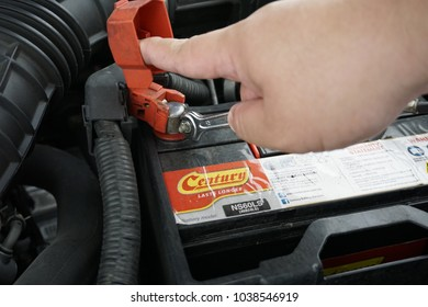 Melaka, Malaysia - March 3, 2018: Process of changing the car battery using tools.