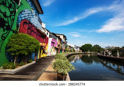 MELAKA, MALAYSIA - May 1: Footpath behind the old house of Melaka on May 1, 2015 in Melaka, Malaysia. Footpath on riverside which colorful painting on the wall.