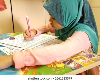 Melaka - Malaysia - Nov 26, 2020 : A female student is doing a module exercise given by the teacher while the area is still in control movement.