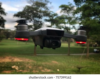 MELAKA, MALAYSIA - NOVEMBER 18, 2017: Picture of the DJI Spark drone hovering mid air. DJI Spark is the smallest hobby drone by DJI.