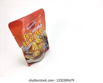 Melaka / Malaysia - November 18 2018 : Jasmani Sour and Spicy Paste or Asam Pedas Pes over white background.