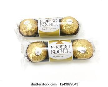 Melaka / Malaysia - November 28 2018 :  Ferrero Rocher chocolate and hazelnut confectionery balls on a white background.